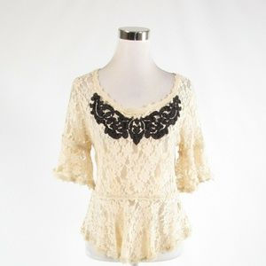 Light beige FREE PEOPLE peplum blouse M
